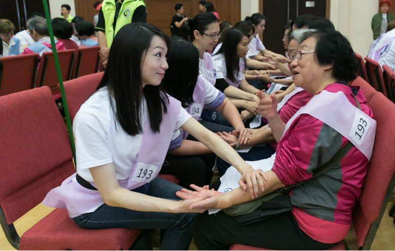 Most people receiving a hand massage simultaneously