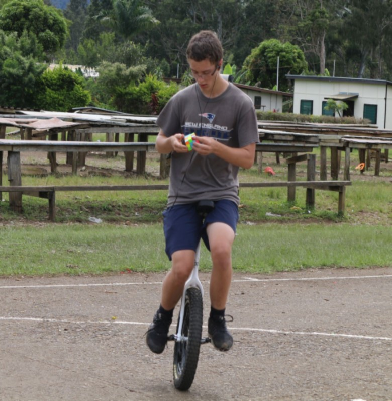 Most rotating puzzle cubes solved on a unicycle