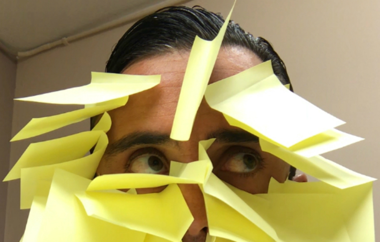 Most sticky notes stuck on the face in 30 seconds