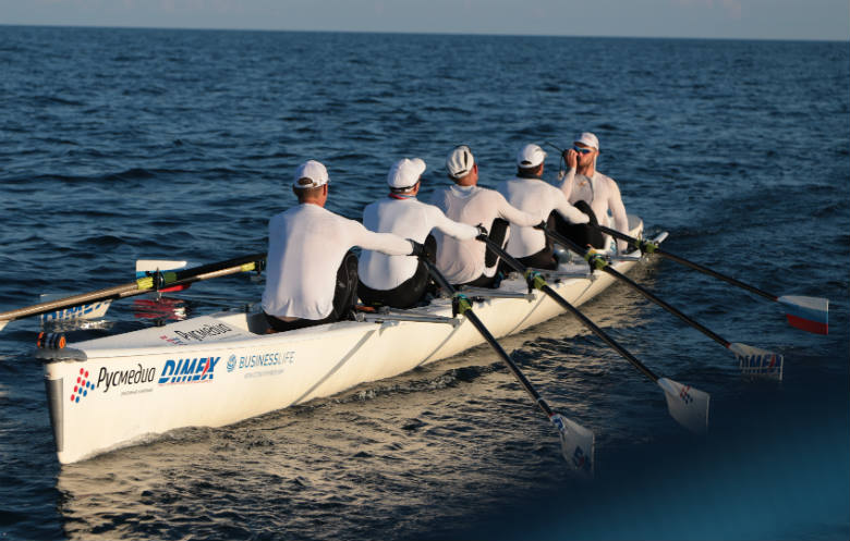 Greatest distance rowed in open water in 12 hours (team)
