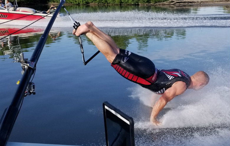 Greatest distance waterskied on both hands