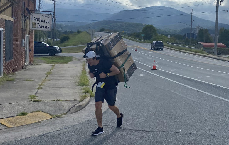 Fastest half marathon carrying a household appliance (white goods) (male)