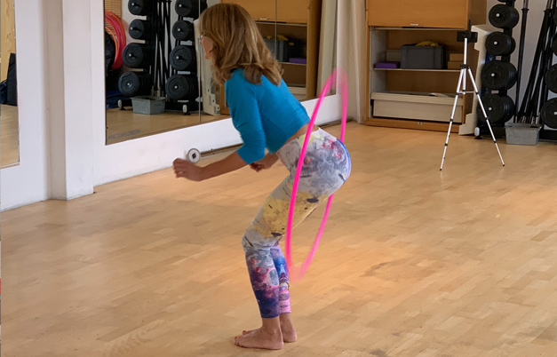Most hula hoop rotations around the bum in three minutes