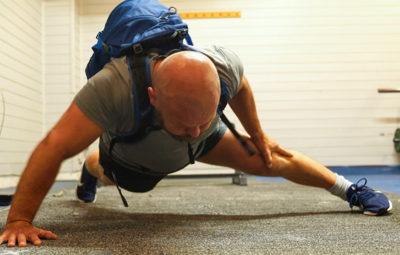 Most one arm push ups carrying a 60 lb pack in one minute