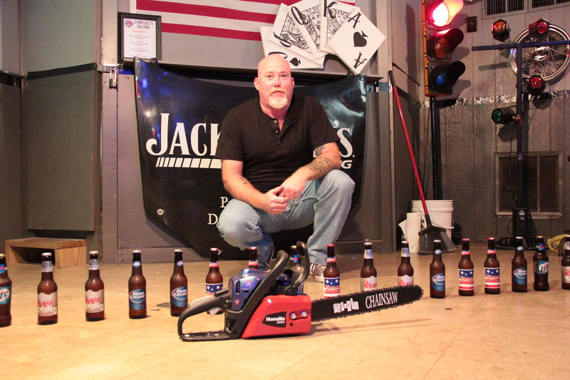Most beer bottles opened by chainsaw in one minute